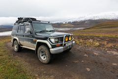 Off-road expedition auto Toyota Land Cruiser Prado parked on mountain road. KAMCHATKA PENINSULA, RUSSIA - SEP 17, 2016: Extreme off-road expedition auto Toyota stock photos