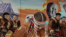 Portrait of young woman dancer in national clothing indigenous Kamchatka decorated with red fox stock footage
