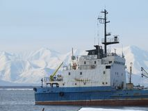 Kamchatka Russia. Cargo ship at the pier in the Pacific stock image