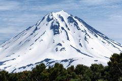 Snowy cone of Vilyuchinsky Volcano on Kamchatka Peninsula Stock Photo