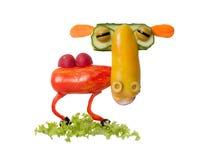 Kamel som göras av nya grönsaker på isolerad bakgrund Arkivbild