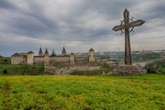 Kamenetz-Podolsk fortress and cross is established as memory. Of the dead for will of Ukraine stock photography