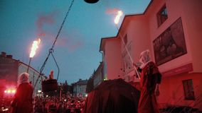 Performers of fire show come round street stage before audience. stock video