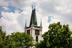 Kamenna vez Stony tower with clocks of the Church of All Saints in Litomerice Stock Images