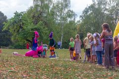 Holiday day of the village with animators and childrens playgrounds and competitions in the park in the autumn. Kamennomostsky, Russia - September 1, 2018 royalty free stock photography
