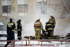 Kamensk-Uralsky, Russia, February 10, 2018: Firefighters on the site of a fire, smoke from a well in which was a fire stock image