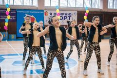 Championship of the city of Kamenskoye in cheerleading among solos, duets and teams. Kamenskoye, Ukraine - March 9, 2017: Championship of the city of Kamenskoye Royalty Free Stock Photos