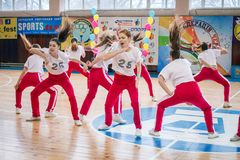 Championship of the city of Kamenskoye in cheerleading among solos, duets and teams. Kamenskoye, Ukraine - March 9, 2017: Championship of the city of Kamenskoye Stock Image