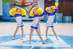 Young cheerleaders perform at the city cheerleading championship. Kamenskoye, Ukraine - March 9, 2017: Championship of the city of Kamenskoye in cheerleading Royalty Free Stock Photos