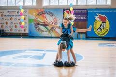 Young cheerleaders perform at the city cheerleading championship. Kamenskoye, Ukraine - March 9, 2017: Championship of the city of Kamenskoye in cheerleading Stock Images