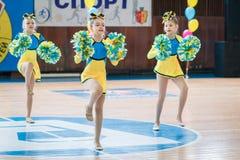 Young cheerleaders perform at the city cheerleading championship. Kamenskoye, Ukraine - March 9, 2017: Championship of the city of Kamenskoye in cheerleading Stock Photo