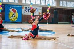 Young cheerleaders perform at the city cheerleading championship. Kamenskoye, Ukraine - March 9, 2017: Championship of the city of Kamenskoye in cheerleading Royalty Free Stock Photo