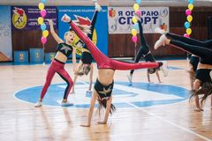 Championship of the city of Kamenskoye in cheerleading among solos, duets and teams. Kamenskoye, Ukraine - March 9, 2017: Championship of the city of Kamenskoye Stock Photography