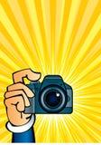 Kamera in der Hand Lizenzfreies Stockfoto
