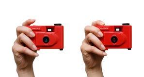 Kamera in einer Hand Lizenzfreie Stockfotografie