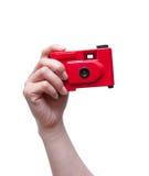 Kamera in einer Hand lokalisiert auf weißem Hintergrund Lizenzfreies Stockfoto