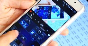 kamera för fjärrkontroll för mobiltelefon 4k idérik, teknologi för trådlös telefon stock video