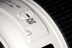 Kamera för lins för fokusströmbrytare på fotografering för bildbyråer