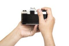 Kamera för maninnehavfilm royaltyfri foto