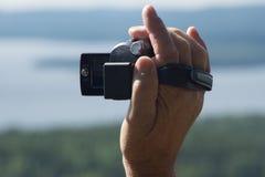 Kamera Hand beim Filmen Stockbild