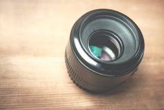 Kamera obiektyw na biurku Fotografia Stock