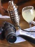 Kamera och drink Fotografering för Bildbyråer