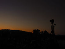 Kamera och solnedgång Arkivbilder