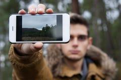Kamera telefonu wisząca ozdoba Fotografia Stock
