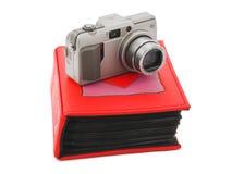 Kamera- und Fotoalbum lizenzfreie stockfotos