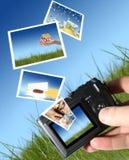 Kamera und viele Abbildungen. Lizenzfreie Stockbilder