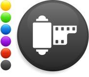 Kamerabandspuleikone auf runder Internet-Taste Stockbild