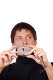 kameracompact som gör manfotobarn Arkivfoton