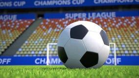 Kameraflyttning in mot en fotbollboll som ligger på gräs i en tom stadion arkivfilmer