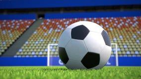 Kameraflyttning in mot en fotbollboll som ligger på gräs i en tom stadion stock video