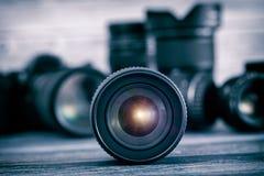 Kameralins med lensereflexioner Arkivbild