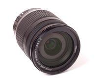 Kameralins som isoleras på en vit bakgrundscloseup Fotografering för Bildbyråer