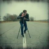 Kameraman som gör en film Arkivbild
