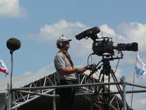 Kameramanfilmande Fotografering för Bildbyråer