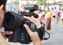 Kameramaninspelningvideo Arkivfoto
