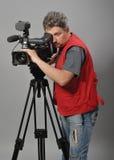 Kameramann in der roten Weste Stockfoto