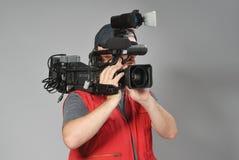 Kameramann in der roten Weste Stockbilder