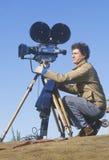 Kameramann, der seine Kamera installiert Stockfotografie