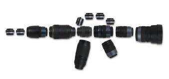Kameraobjektiv-Gewehrform lokalisiert auf weißem Hintergrund Lizenzfreie Stockfotos
