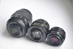 Kameraobjektive auf weißem Hintergrund stockbild