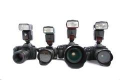 Kameras mit Blinken auf weißem Hintergrund Lizenzfreie Stockfotos