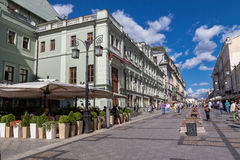 Kamergersky lane in Moscow, Russia. Moscow, Russia - August 14, 2015:Summer cafe and Chekhov theater in Kamergersky lane Royalty Free Stock Image