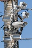 Kameror monteras på stolparna Royaltyfri Foto
