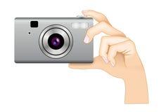 kamery cyfrowa ręki fotografia Fotografia Royalty Free