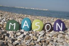 Kamieniarz, samiec imię na colourful kamieniach na otoczakach Fotografia Royalty Free