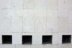 Kamienna ściana z cztery okno zamyka up zdjęcie royalty free